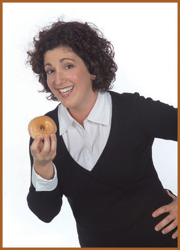 20 something woman eating donut